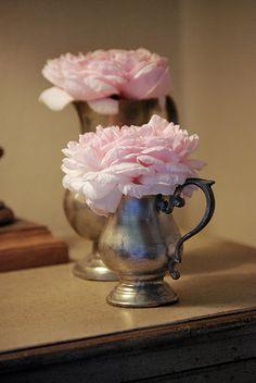 Roses in antique vases
