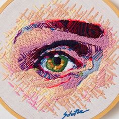 Amazing eye embroidery by this realistic thread painting uses a beautiful mix of stitching techniques to achieve light and shadow around the eye Contemporary Embroidery, Modern Embroidery, Diy Embroidery, Cross Stitch Embroidery, Embroidery Patterns, Embroidery Floss Projects, Portrait Embroidery, Thread Painting, Sewing Art