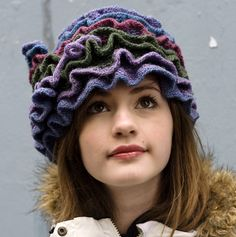 free knitted pattern but thinking this would be easy to crochet, check it out.  It is actually a head band or scarf.