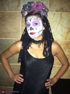 Danielle: I pulled this beauty together in under 6 hours. The face paint was purchased from the party store and I made the head piece from fake flowers, black headband and...