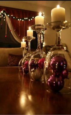 Simple DIY holiday decor using wine glasses! :: Turn wine glass upside down & use it as a glass lid for a small arrangement of Christmas decorations (ornaments, ribbon, whatever you like). Then place mini candles on top! Noel Christmas, Winter Christmas, Christmas Ornaments, Christmas Candles, Christmas Centerpieces, Christmas Balls, Table Centerpieces, Centerpiece Ideas, Simple Christmas