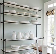 The sole dip into color is the Woodlawn Blue in the breakfast room, a perfect pale backdrop for his black-and-white photos and well-edited collection of white ironstone platters, pitchers and cake stands. ( In Brisbane I have a supplier who can mix Benjamin Moore colours)