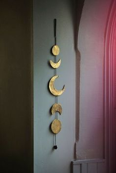 Free People gold moon chime is a fun boho accessory to add to your walls. Get this piece on ShopStyle!