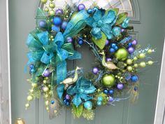 Peacock inspired wreath  Sadly, no link...anyone know where this came from?