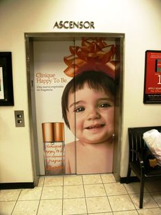 Photo Tex for removable and reusable signage on elevator doors.