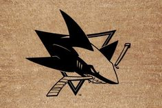 NHL San Jose Sharks Flocked Door Mat by The Memory Company. $19.99. This coir fiber doormat proudly displays the team graphic in the center, so all of your guests will know that you are a die-hard fan. Measures approximately 20 x 30 inches.