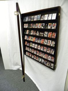 A display case presents the inner-self of the creator. With a look at the display case, you can know the person inside. There are DIY display case ideas. Sports Memorabilia Display, Baseball Card Displays, Hockey Cards, Baseball Cards, Karten Display, Man Cave Lighting, Ultimate Man Cave, Man Cave Home Bar, Card Storage