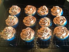 Vanilla M cupcakes with chocolate buttercream frosting