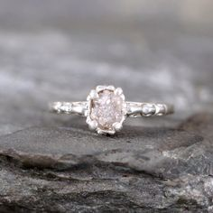 Raw Uncut Rough Diamond Solitaire and Sterling Silver Filigree Ring - Conflict Free Diamond - Antique Styled Engagement Ring by ASecondTime on Etsy https://www.etsy.com/listing/188727029/raw-uncut-rough-diamond-solitaire-and
