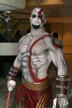 Kratos from God of War looking for Zeus by the escalator