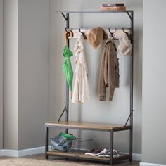Townsend Hall Tree - The Townsend Hall Tree adds style and functionality to your home decor. This beautiful rack is made with a metal frame, quality wood, and a natural fi...