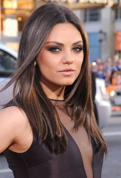 Mila styled her hair almost impossibly sleek and glossy at the premiere of her film Ted in 2012. She juxtaposed her simple hairstyle with a smoky metallic eye, thick black liner, and incredibly glossy pink lips.