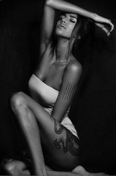 Tattoo beauty in white dress