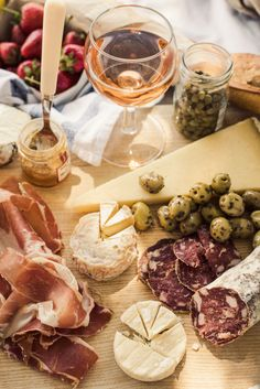 A picnic in Provence with local foods from the daily market, spread out under the cherry trees over looking the Marquis de Sade's ruined castle in France.
