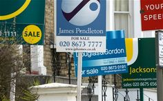 For sale signs in front of a house in London