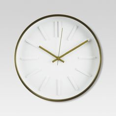 """• Made of a glass and metal with a brass finish<br>• Reliable quartz movement<br>• Measures 13""""x13""""x2.5""""<br><br>The 13"""" Wall Clock with Raised Marker in Brass from Threshold blends with a streamlined décor. This kitchen clock uses tick marks to indicate the hours with a double tick for twelve, and includes an hour, minute and second hand."""