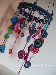 crochet mobile / gives me an idea.. Wrap a hoop with yarn/ribbon and hang beads for a different look.