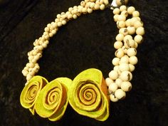 We love our new necklaces, made from all natural materials. The roses in this one are made from Orange Peel!