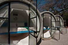 At Tubohotel, you book your own private giant concrete drainage tube, which includes a queen-sized bed, bedding, storage, curtains, and lighting.