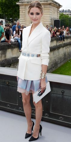 Palermo went top to toe in Christian Dior, belting an ivory blazer over an iridescent organza skirt, complete with embellished cuffs, white clutch and black pumps.