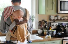 Daddy + babywearing + doing dishes = most attractive thing ever.