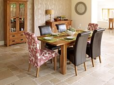 4 leather chairs and 4 patterned chairs similar to these to go with the DIY farmhouse table