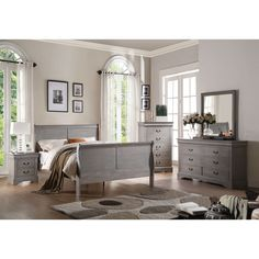 A grey wood build and elegant sleigh style design make this bed the perfect complement to any classic or contemporary sleeping space. Carefully designed for function and form, this piece offers a fres