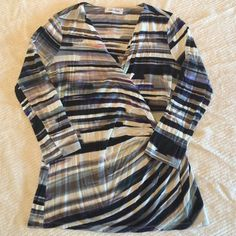V neck blouse Multicolored vneck blouse.  Material label is missing but there is some spandex in the blouse. The front of the blouse drapes over to form the vneck. Calvin Klein Tops Blouses