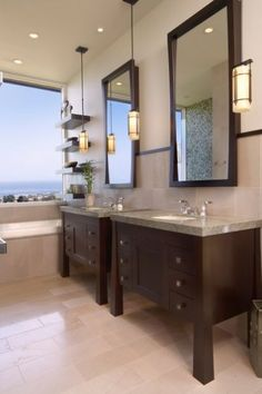 Installing two identical off-the-shelf single vanities next to each other is a solution when the bathroom is large enough for a double vanity but the budget is not - LOVE this!!!