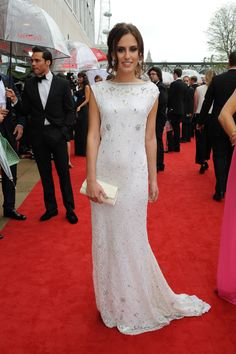 MIC's Lucy Watson in a glitzy gown with an Untold clutch