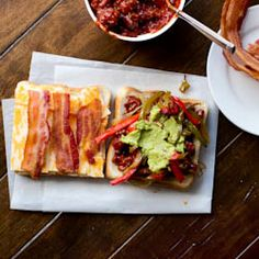 The ultimate grilled cheese piled with guacamole, a special sauce, onions, peppers, bacon galore!