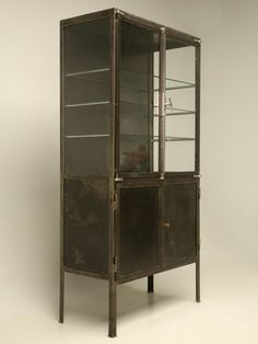 Vintage Metal and Glass Cabinet by Livypalm