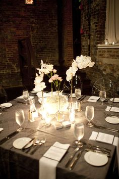 Love this modern centerpiece with those tall clear vases, gorgeous!