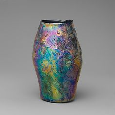 Vase  Designed by Louis Comfort Tiffany (American, New York City 1848–1933 New York City)  Maker: Tiffany Glass and Decorating Company (1892–1902)   Maker: Tiffany Studios (1902–32) Date: 1912   Geography: Mid-Atlantic, New York City, New York, United States Culture: American   Medium: Favrile glass   Dimensions: H. 5 1/16 in. (12.9 cm)