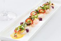 Tiradito-style scallop and prawn ceviche, with yam, edamame jalapeno and rocoto harissa crema.