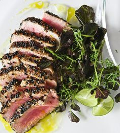 Sesame seared ahi tuna with lime ginger vinaigrette. Goes very well with a fennel, arugula, grilled asparagus and avocado side salad served with the same vinaigrette.