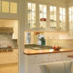 glass doors on both sides of the upper cabinets