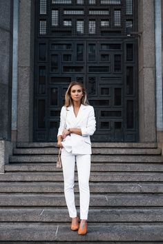 Lisa Olsson white suit orange suede heels
