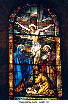 Crucifixion of Jesus depicted on stained glass window. Palo Alto California USA - Stock Image