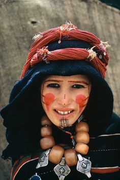 Morocco.Imilchil.Young bride of Ait Haddidou tribe wearing capes of Amazigh design and covered in silver ornements.1972