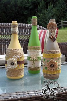 tiki wine bottles, design d cor, diy home crafts, repurposing upcycling, Keep the feel of summer with some green and yellows (Bottle Design Vases) Wine Bottle Art, Painted Wine Bottles, Diy Bottle, Wine Bottle Crafts, Bottles And Jars, Decorated Bottles, Bottle Lamps, Alcohol Bottles, Juice Bottles