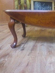 use a vintage drop-leaf coffee table but with a custom base so it
