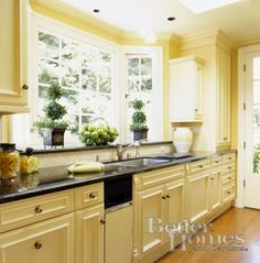 colorful kitchen cabinetry | cherry cabinets, golden yellow and