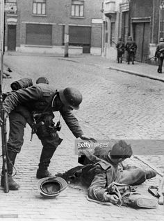 campaign in the west (battle of France) street fight in a french town - german soldier caring about an injured french Soldier. without further information, end of May 1940 - pin by Paolo Marzioli German Soldiers Ww2, German Army, Man Of War, World War One, Vietnam War, Military History, Wwii, Battle, French Army
