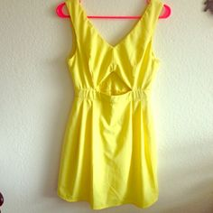 """Yellow dress Solid yellow dress with a triangle hole in the front, worn only once for a graduation party, no stains holes or snags. High waisted dress. Bust: 32-36"""". Length from shoulder to bottom: 33-34"""". Length from waist strap to bottom: 20-21"""" Forever 21 Dresses"""