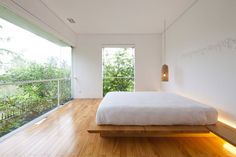 house is located in a residential area of HoChiMinh's suburban. Completed in this contemporary house is located in Ho Chi Min City, Vietnam.The architects used for this house na… Minimalist Interior, Minimalist Living, Minimalist Bedroom, Storey Homes, Minimal Home, Floating, Dream Bedroom, Peaceful Bedroom, Modern House Design