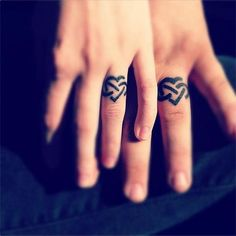 Infinity tattoo ring.. thinking of doing something similar to this with Tom.. been thinking of this for some time now..