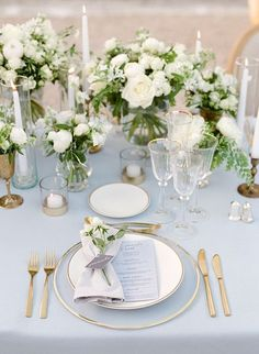 A Chic, Family-Oriented Destination Wedding in France The delicate place settings included glass chargers, matte gold cutlery, tulip-shaped glasses, and. Martha Stewart Weddings, Wedding Table Decorations, Wedding Centerpieces, Blue Centerpieces, Masquerade Centerpieces, Quinceanera Centerpieces, White Centerpiece, Centerpiece Flowers, Table Flowers