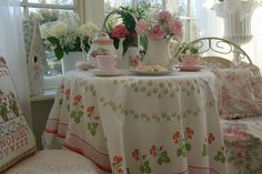 Lots of Pink & Pretty Florals. Love the vintage tablecloth
