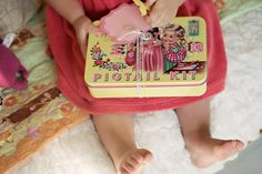 Pigtail kit: fill with headbands, bows, clips, mini brush/comb and mirror.